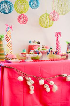 Love the Yarn balls for Room Decor.  Like the idea of having a tree branch across the front of the table. Maybe poster board with Coffee Filter flowers.
