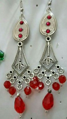 Oxidized chandelier earrings with graded  red beads