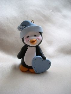 Adorable Penguin Sculpted from Polymer Clay - Christmas ornament - LOVE his little stitched heart! Available from clayqts via Etsy - handmade ornaments