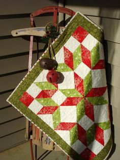 Carpenter's Wheel Christmas Quilt Could be done with half square triangles?