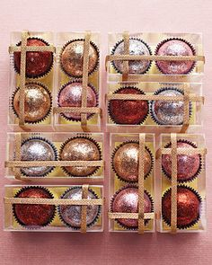 """Glittery chocolates (or """"bedazzled bonbons"""") double as wedding favors and sparkly table decor: http://www.bedazzlemybonbons.com/boxes.asp"""