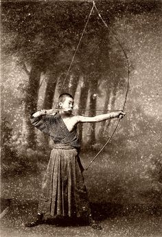 A young Archer holding his bow in the Kai (full draw) position.