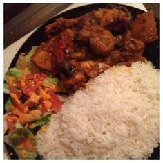 Stewed chicken with batata or boniato a type of sweet potato that's common in the carribean with white rice and salad