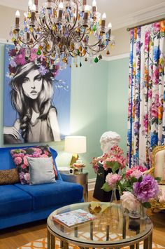 Colorful chandelier makes this space pop! Click for more ideas on how to decorate your home with chandeliers!
