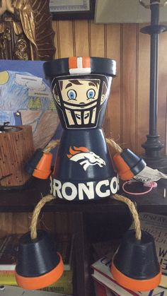 Broncos clay pot people hand done by me
