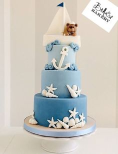 A super cute nautical themed cake with seashells, anchor, boat and teddybear. I love the ombre effect. Would be ideal for a nautical baby shower!