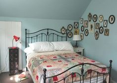 I love the black brass bed with the cameo black frames stretching across the corner in the back!!