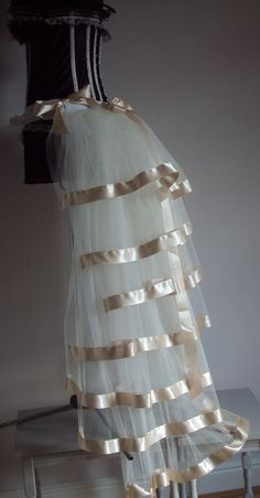 Ivory Cream Bridal bustle belt made from dress net tulle trimmed with Satin Ribbon  7 layers full longer 46in length could be worn at lots of occasions .