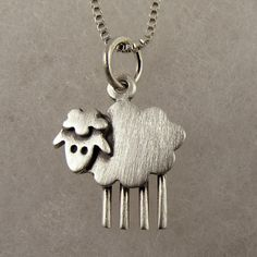 Hey, I found this really awesome Etsy listing at https://www.etsy.com/listing/97345869/tiny-sheep-necklace