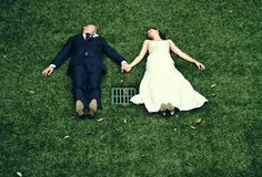 Bride and Groom lying on ground by sewer grate Funny Wedding Pictures Bad Wedding Photos Pics Crazy Wedding Ideas Planning Awkward Family Ph...