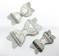Check out this item in my Etsy shop https://www.etsy.com/uk/listing/558382866/christmas-bow-sleepy-star-bow-silver