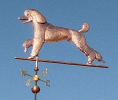 Poodle Dog Weathervane Running  by West Coast Weather Vanes.  Glass eye color can be selected to accommodate a  variety of dog eye colors.  Personalized dog weathervanes can feature gold-leafing to bring out your pet's distinctive markings, as well as dog collars bearing your dog's name.