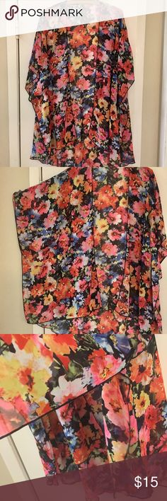 ⭐️PRICE IS FIRM⭐️Colorful Floral Kimono💕 Thin sheer material. It's shorter in the front. Have side slits for easier movement and arm holes. Please look at the pictures carefully. Very nice condition. No tags. Fits up to a xl. I'm plus fits me open though. Tops