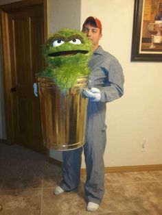 Oscar, most awesome costume ever!!! Than arms aren't real, they're just connected to the trashcan!