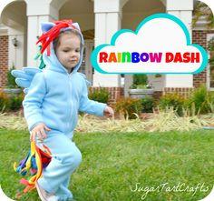 Little girl running in yard wearing My Little Pony Rainbow Dash costume