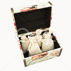 Qdiz Stock Photos | Gift box with textile pouches,  #background #bag #bow #box #burlap #cloth #container #craft #decoration #decorative #fabric #filled #gift #handmade #homemade #isolated #material #package #packaging #packet #poke #pouch #present #ribbon #sac #sachet #sack #small #sparse #textile #white
