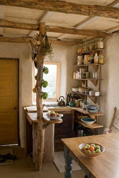 tiny kitchen: LOVE the wood beams that still look like trees. love it love it love it