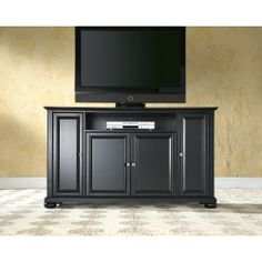 """Alexandria 60"""" TV Stand in Black Finish  rushed Nickel hardware adds a touch of style to this already beautiful cabinet.  There is plenty of storage space and wire management behind the beautiful raised panel doors to hide electronic components, gaming consoles, DVDs, and other items that you would prefer to be out of sight. The 59 3/4"""" width means that this cabinet is perfect for most 60"""" TV's."""