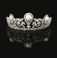 Rare and impressive natural pearl and diamond tiara, Chaumet, 1920. Designed as a graduated series of foliate scrolls set with rose, single- and circular-cut and cushion-shaped diamonds, highlighted in the centre with a large baroque button-shaped natural pearl and two button-shaped natural pearls. Created in 1920 for the marriage of Prince Alexandre Murat to Yvonne Gillois.