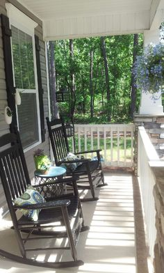 My southern front porch design. The black rocking chairs are beautiful,