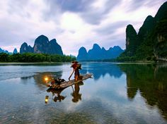 Guilin, China - the bamboo rafts are a bit narrow.but I figured they have been using the same make and model for thousands of years, so why not? My sons were 6 and 9 - what an adventure for us all! National Geographic Travel, Famous Gardens, Guilin, Travel Videos, Magic Carpet, Rafting, Trip Planning, Sons, Bamboo