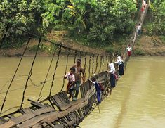 25 Of The Most Dangerous And Unusual Journeys To School In The World.pupils crossing a damaged suspension bridge, Lebak, Indonesia Schools Around The World, Around The Worlds, Values Education, Education Posters, Walk To School, School School, School Today, Dangerous Roads, Jolie Photo