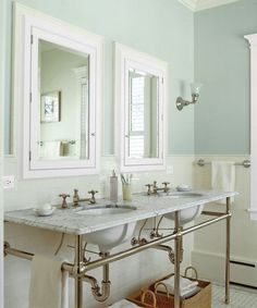 A new bath gets a vintage-look makeover with reproduction fixtures that include a console double sink and wood-framed, recessed medicine cabinets from Waterworks, a towel bar from Chicago Brass, and a sconce from Rejuvenation. | Photo: Nathan Kirkman | thisoldhouse.com