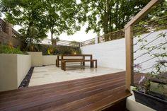 Walled garden with Balau decking & sandstone slabs.