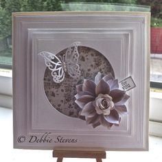 Spellbinders grand squares, Spellbinders classic circle large, joy crafts butterfly, Crafters companion desire quilled large rose, marianne designs rolled flower, sentiment tag is lili of the valley.