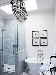 """The crystal ship chandelier """"was a whimsical last-minute selection,"""" says designer Ken Fulk about the master bath in a Victorian San Franciscan house."""