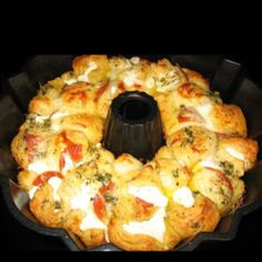 "Pizza Monkey Bread -- 2 cans ""grands-type"" biscuits, cut into 1/4's; 1 stick butter; 1-2 tsp chopped garlic; 1 to 1-1/2 tsp Italian seasoning; 1 Tbsp chopped chives; 1 package pepperoni, shredded cheese.  In small saucepan, melt butter with garlic & seasonings. Stir until butter is melted. Spray a Bundt pan with non-stick spray & brush sides of pan with a little of the butter/garlic mixture. Taking 1/4'd biscuits, flatten slightly & place a pepperoni & a little cheese inside & roll into a…"