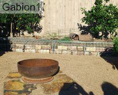 gabion wall behind a firepit http://www.gabion1.com.au