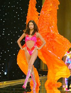 Adriana Lima Victoria's Secret Fashion Show Pictures | POPSUGAR \ Looking at Adriana Lima, it's hard to believe that she started her journey as a Victoria's Secret model all the way back in 1999! Every year she manages to turn heads on the runway in decadent costumes that range from sporty to supersexy. She's sported wings since as early as 2001 and opened the show on multiple occasions, an impressive feat. Though the model took 2009 off due to her pregnancy, she was right back. #VSFS_2002