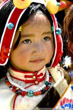 Little girl dressed traditionally at Yushu Horse Festival, traditional Kham region of Tibet | circa 2006