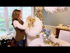 Decorating with Feathery White Boas--These fluffy boas look like snow and are great coupled with glittery things.  Even includes instructions on how to make a simple boa wreath.