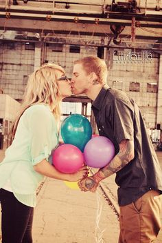 Balloons, vintage, engagement session, train station, couple portraits, kissing pose, photo by Lillabella Photography
