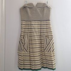 Anthropologie strapless dress 8 Maeve for Anthro beautiful cotton/linen strapless dress. Grey & cream striped w/Kelly green grosgrain under hem. 2 pickets in front. Lined w/ black scalloped hem. 3 wood button up in the back. So pretty for the spring & summer. Worn once. Dry cleaned. Size 8 Anthropologie Dresses Strapless