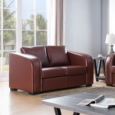 Modernize your living room with this comfy loveseat. This loveseat features firm seats with pocket coil cushions and piping design. The rich brown finish allows for a sleek modern feel.