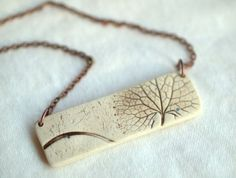 porcelain pendant by pfeiffer studios on etsy- experiment with silver clay?