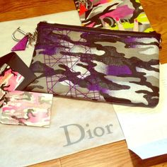 "RARE CHRISTIAN DIOR REYLE CAMO CLUTCH This is an AUTHENTIC limited edition Anselm Reyle for Dior collection purple Camo clutch. ABSOLUTELY FLAWLESS as it has never been used. Hard to photograph serial as it is far down inside the clutch, but the number is 02-LU-1101. Comes with dust bag and collectible authenticity cards and catalogue. I also have original receipt. Measures approx 9.5"" x 6.5"". Yes I am asking more than I paid due to the rarity of the clutch. Beautiful piece for any…"