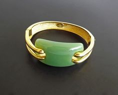 Vintage Bracelet Givenchy 1976 Green Jade Lucite Designer Hinged Bangle Signed Dressy Casual Womens Accessories. $ 155.00, via Etsy.