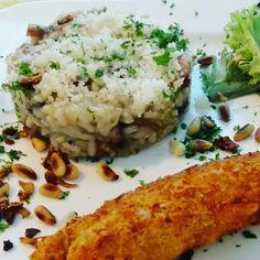 Risotto met paddestoelen en spekjes  afgeblust met witte wijn, parmezaanse kaas, Pijnboompitten en een gepaneerd stukje kip