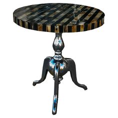 End table with striped top and iron pedestal base.Product: End table   Construction Material: Acrylic and polyester
