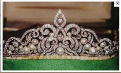 The diamond and pearl tiara, currently worn by Countess Marianne, circa 1890s. Designed as a series of diamond scrolls, scattered with button pearls of various sizes.