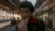 In the opening scene of Saturday Night Fever Tony Manero bought two slices of pizza from Lenny's Pizza in Bensonhurst and ate them stacked. Brooklyn Pizza, Brooklyn New York, New York Pizza, Dance Movies, Saturday Night Fever, The Big Hit, John Travolta, Cult Movies