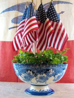 Even if you're not hosting a gathering soon, summer is a great time to embrace red, white and blue accessories. Perfect for a console or accent table, this planter looks timelessly patriotic. Photo: maisondecina.com