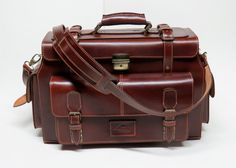 Leather Briefcase //Train Case // Handbag // Leather Messenger Bag Its handmade from top quality Vegetable Tanned Leather. Very solid and strong in structure >> 1 Front pocket with straps & buckle closures >> 2 side pockets with Tuck Lock >> Inside pockets for mobile, credit cards >> Adjustable narrow shoulder strap (2.8cm wide) with quality square buckle closures Measures: - length 44 cm (17 inches) - width 20 cm (8 inches) - hei...