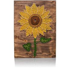 Create this beautiful Sunflower String Art Kit that way you can hang it up for display. The Sunflower's eye popping colors nailed to a beautiful piece of stained wood is unique home decor that only yo