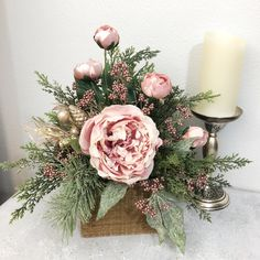 This beautiful centerpiece can be viewed from all sides. It will make for a statement piece in your home this holiday season #shabbychicchristmas #christmascenterpiece #christmasarrangements #pinkchristmas