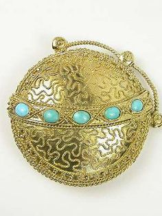 Etruscan Revival Turquoise Antique Brooch, PN-1971  Globe-inspired Etruscan Revival turquoise antique brooch. The greenish-blue hue of five oval cabochon turquoise stones. 18k yellow gold setting. Twisted rope design. Top set with golden beads.  Circa 1860.   Perfect for Civil War period clothing!